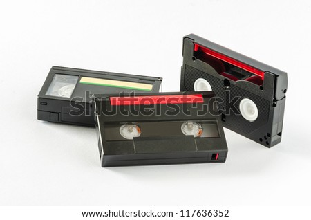 Set of videocassettes on white background