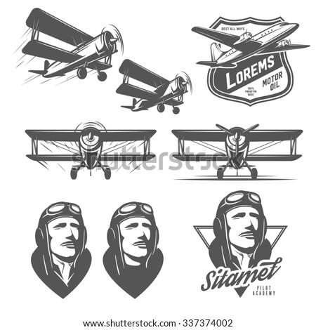 Set of vintage aircraft design elements. Biplanes, pilots, design emblems - stock photo