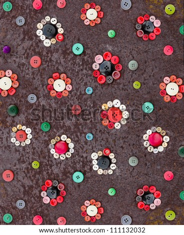 Set of vintage buttons on old rusty table - stock photo