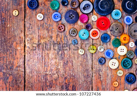 Set of vintage buttons on old wooden table - stock photo