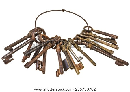 Set of vintage rusty keys attached on a ring isolated on a white background - stock photo