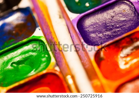 set of watercolor paints, shallow depth of field - stock photo