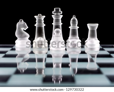 Set of white chess pieces over black
