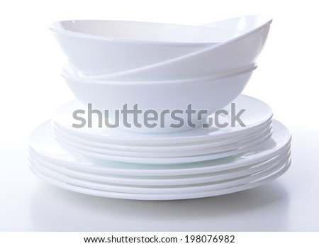 Set of white dishes isolated on white