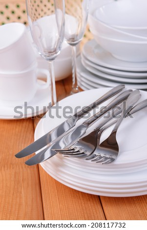 Set of white dishes on table close-up - stock photo