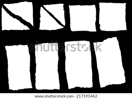Set of white torn paper isolated over black background - stock photo