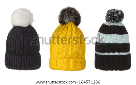 set of winter hats with pompon isolated on white  - stock photo
