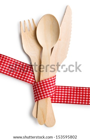 set of wooden cutlery on white background - stock photo