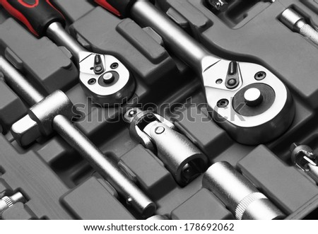 Set of wrenches on box - stock photo