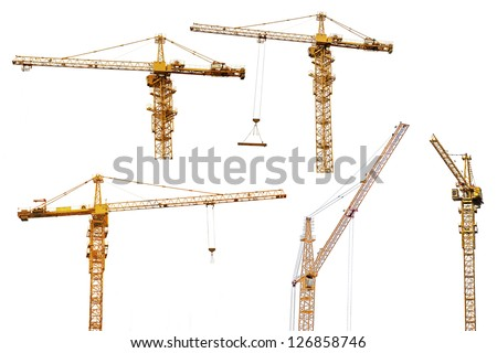 set of yellow hoisting cranes isolate on white background - stock photo