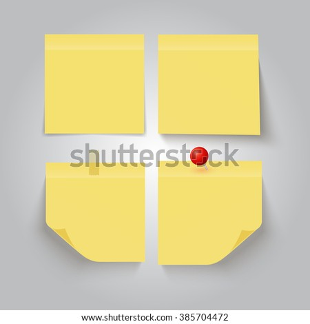 Set of yellow sticky notes on grey background.