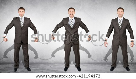 Set off businessmen in handcuffs on grey background - stock photo