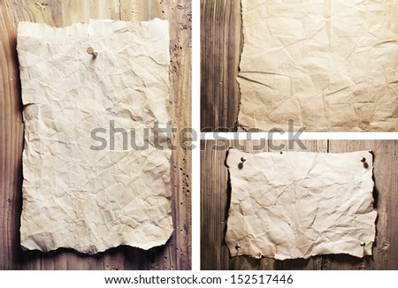 set old crumpled paper are on a wooden wall - stock photo