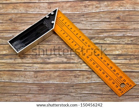Set-square isolated on old wood background