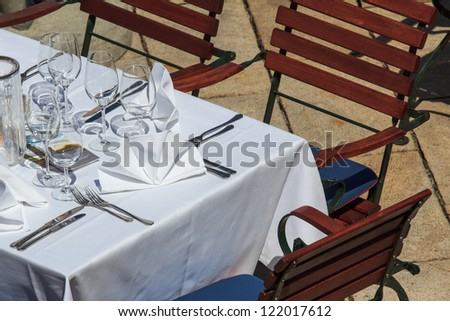 Set table on a restaurant's terrace in Austria - stock photo