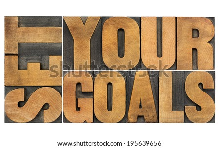 set your goals  - isolated word abstract in vintage letterpress wood type