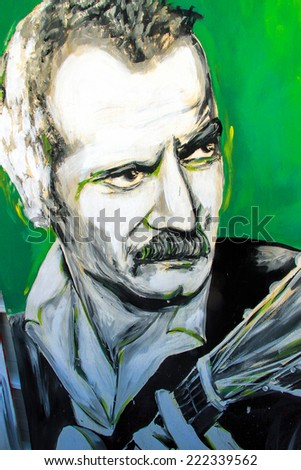 SETE, FRANCE  - SEPTEMBER 21, 2014: Graffiti portrait of Georges Brassens - famous french poet and singer, on the wall of Sete, south of France.