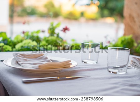 Setout table with tableware in modern restaurant. - stock photo