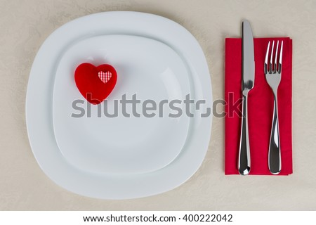 setting table concept / Toy heart on the plate