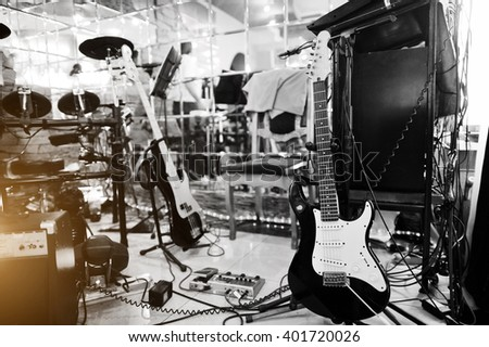 Setting up guitar audio processing effects and electric guitar - stock photo