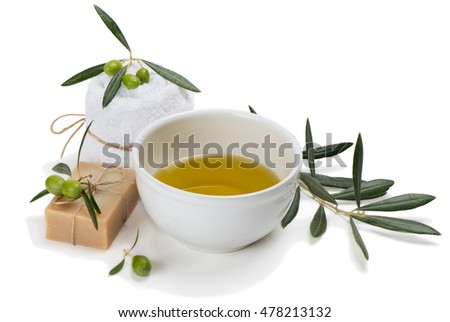 Setting with green olives and olive oil isolated on white background. Hands Spa. Manicure concept.