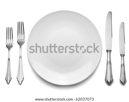 Setting with Plate, Knifes & Forks (clipping path) This set is old, it is not brand new, the flaws in the silverware are natural. This set has often served. - stock photo