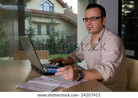 Settlement bills on-line using credit card and laptop