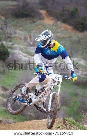 "SEVASTIPOL, UKRAINE - APRIL 10: Racer Roman Chuikov on competition of mountain bike ""Fort Balaklava 2011"" on April 10, 2011 in Sevastopol, Ukraine - stock photo"