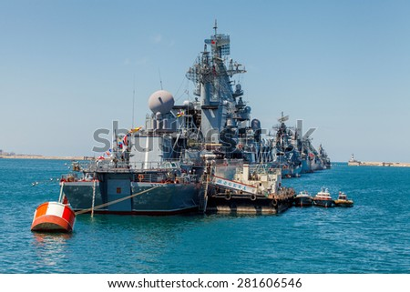 SEVASTOPOL, CRIMEA - MAY 9: Parade of the Russian warships celebrating in honor of 70th anniversary of Victory Day on May 9th, 2015 Russian Navy flagship cruiser Moskva in the Sevastopol Bay, Crimea