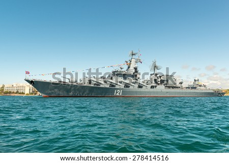 "SEVASTOPOL, CRIMEA - MAY 9: Parade of the Russian warships celebrating Victory Day on May 9th, 2015. Russian Navy flagship cruiser ""Moskva"" in the Sevastopol Bay, Crimea - stock photo"