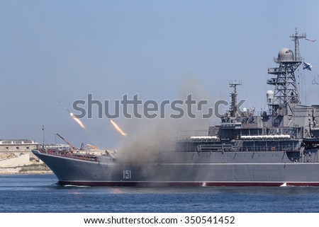 "SEVASTOPOL, RUSSIA - JULY 26, 2015: The Large Landing Ship ""Azov"" of the Russian Navy makes missiles launch during Marine Parade on the Navy day in Sevastopol bay, Crimea Republic - stock photo"
