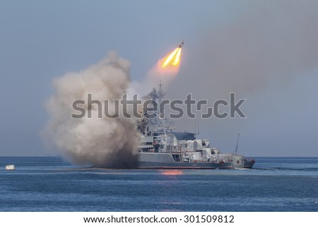"SEVASTOPOL, RUSSIA - JULY 26, 2015: The missile frigate ""Ladny"" of the Russian Navy makes missile launch during Marine Parade on the Navy day in Sevastopol bay, Crimea Republic - stock photo"
