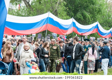 SEVASTOPOL, RUSSIA - MAY 09: Celebrating the 69th anniversary of the Victory Day and 70th anniversary of Sevastopol liberation from fascists. Sevastopol 2014. Parade, people celebrating this holidays  - stock photo