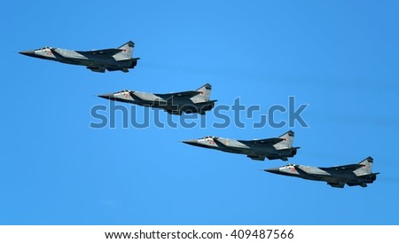 SEVASTOPOL, RUSSIA - MAY 06, 2014: The formation of Russian Air Force Mig-31 foxhound supersonic interceptor aircraft flying to rehearsal of the great victory day parade in Sevastopol