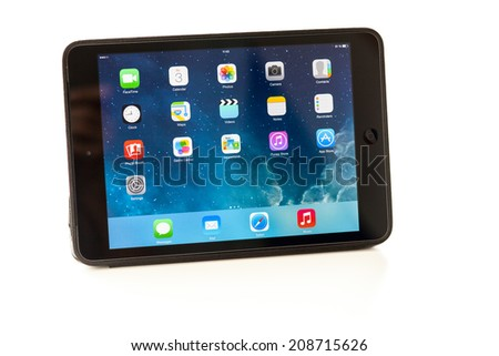 Sevastopol, Russian Federation - August 3, 2014: Apple iPad mini is a tablet produced by Apple Inc. displaying iOS 7.1 homescreen. iOS 7.1 operating system designed by Apple Inc. output 10 March 2014. - stock photo
