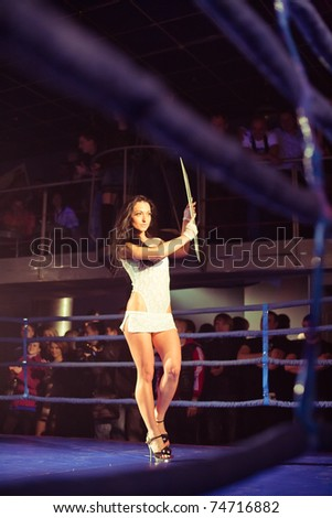 SEVASTOPOL, UKRAINE - 03 APRIL:  girl announces first round at Ukrainian championship MIX FIGHT, April 03, 2011 in Sevastopol, Ukraine. - stock photo