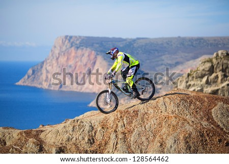 "SEVASTOPOL, UKRAINE - FEBRUARY 13: Unknown racer on the competition of the mountain bike ""FRaction ride 2013"" on February 13, 2013 in Sevastopol, Ukraine - stock photo"