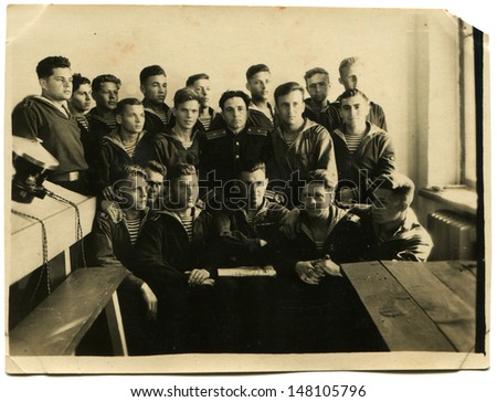 SEVASTOPOL, USSR - CIRCA MAY 24, 1948: Vintage photo shows students with the teacher in the office ASW, Sevastopol, May 24, 1948 - stock photo