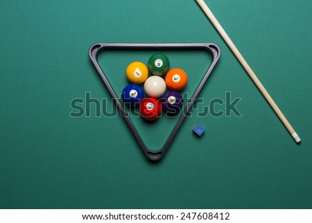 seven billiard balls arranged in the shape of a flower; triangle; chalk; cue game; - stock photo