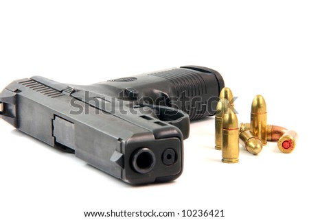 seven bullets and handgun closeup isolated on white background focus on bullets - stock photo