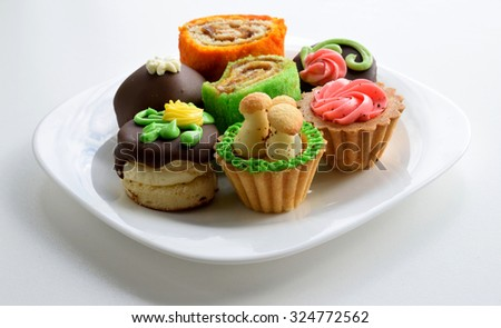 Seven Cakes on white plate - stock photo