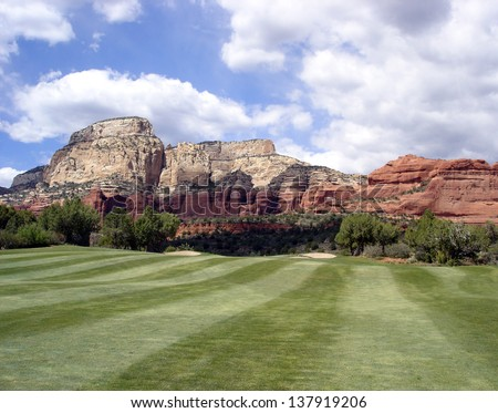 Seven Canyons Golf resort in Sedona, Arizona.  Beautiful landscaped golf course with red rock and blue skies. - stock photo