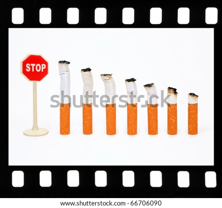 "Seven cigarets and sign ""Stop"" in a film frame - stock photo"