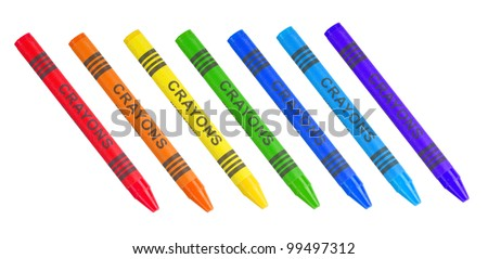 Seven colorful crayons in the colors of the rainbow isolated on white and ready to write