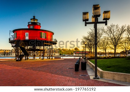 Seven Foot Knoll Lighthouse at sunset, at the Inner Harbor in Baltimore, Maryland. - stock photo