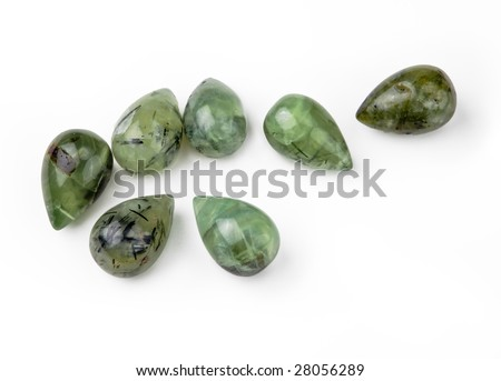 Seven green garnet teardrop-shaped gemstones, isolated on white background