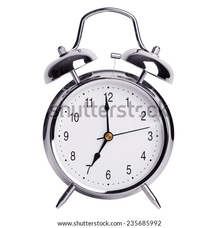 Seven hours on a round alarm clock - stock photo