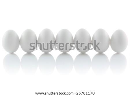 Seven isolated eggs - stock photo