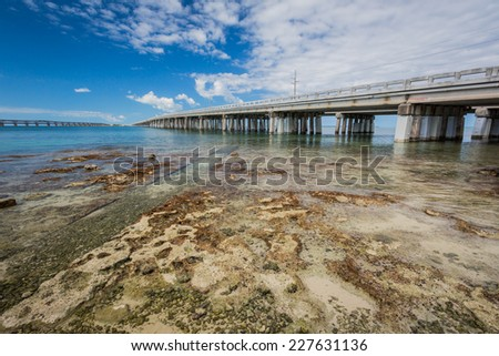 Seven Mile Bridge crosses water in Florida Keys - stock photo