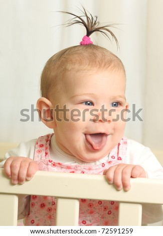 Seven months old happiness girl flick out tongue - stock photo